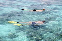 Two boys snorkelling. Two teenager boys snorkelling, Maldives stock photo
