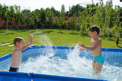 Two boys splashing Stock Image