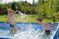 Two boys splashing Royalty Free Stock Images