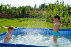 Two boys splashing Stock Photography