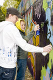 Two boys spray painting royalty free stock image