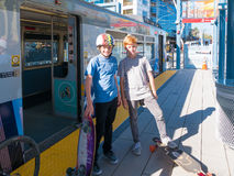 Two Boys Standing On Metro Light Rail Platform With Skateboards Stock Photography