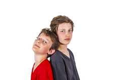 Two boys staying back-to-back Royalty Free Stock Photography