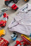 Two boys stripe shirt near set of car toy. Close up. Royalty Free Stock Photo