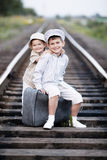 Two boys with suitcase on railways Stock Photography