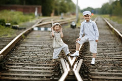Two boys with suitcase on railways Royalty Free Stock Images