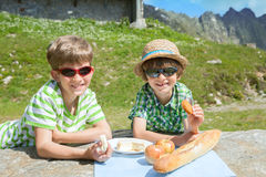Two boys in summer mountains Royalty Free Stock Photography