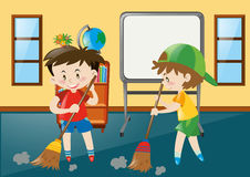 Two boys sweeping classroom floor Stock Photo