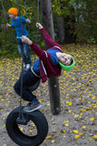 Two boys on swings Royalty Free Stock Photos
