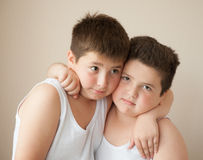 Two boys in t-shirts hugging Royalty Free Stock Photography