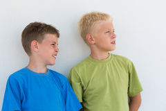 Two boys in T-shirts somewhere looking. Two boys in colored T-shirts somewhere looking stock photo