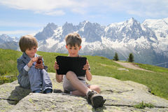 Two boys with tablet PC in Alps Stock Images