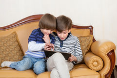 Two boys with tablet PC Stock Images