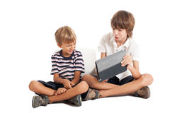 Two boys with a tablet PC Stock Images