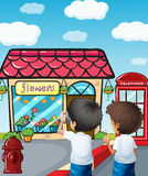 Two Boys Taking Photos Near The Flower Shop Royalty Free Stock Images