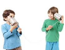 Two boys talking on a tin can phone. Isolated on white Royalty Free Stock Images