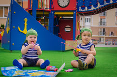 Two boys toddlers pirate costumes (sailors) playing on Playgroun Stock Photography