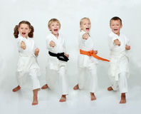 Two boys and two girls are hitting punch arm Royalty Free Stock Photo