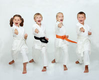 Two boys and two girls are hitting punch arm Royalty Free Stock Images
