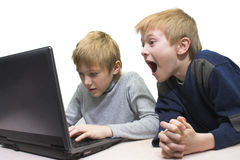 Two boys use notebook. White background Royalty Free Stock Photo