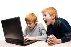 Two boys use notebook Stock Image