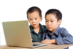 Two boys using notebook stock photos