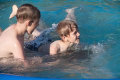 Two boys in water Stock Image