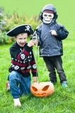 Two boys wearing halloween costumes. And jack-o-lantern Stock Photos
