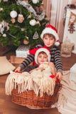 Two boys wearing Santa caps Royalty Free Stock Photos