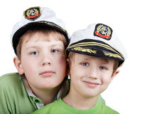 Two boys in white sea peak-caps Royalty Free Stock Images