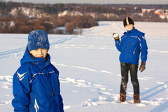 Two boys on winter outdoor. Two similar boys on winter walk Stock Images