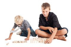 Two boys with wooden bricks Stock Images