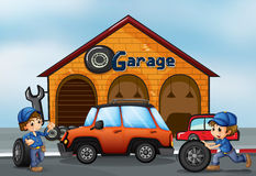 Two boys working at the garage Stock Image