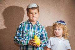 Two boys in yarmulkes Royalty Free Stock Images