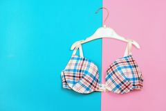 Bra on hanger on two tone background Royalty Free Stock Photo