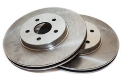 Two brake disks isolated on white background. Two brake disks isolated on a white background Royalty Free Stock Images