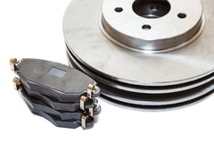 Two brake disks and pads isolated on white background Royalty Free Stock Photo