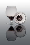 Two brandy glasses. Two glasses of brandy on glass plate with reflection Stock Photo