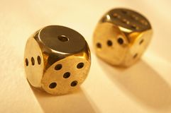 Two brass dice Royalty Free Stock Photography