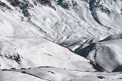 Two brave alpinists hiking mountains covered with deep snow. Extreme lifestyle Royalty Free Stock Photo