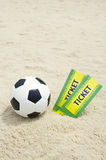 Two Brazil World Cup Tickets Football Soccer Ball Beach. Two tickets to Football World Cup 2014 event in sand on Brazilian beach with soccer ball stock images