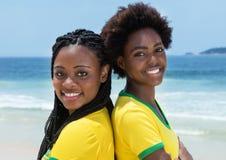 Two brazilian fans at Copacabana beach at Rio de Janeiro. Outdoor in the summer Stock Images