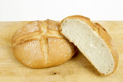 Two bread. Two round bread on a wooden Stock Images