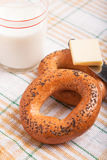 Two bread-ring with milk Stock Images