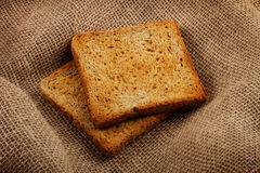 Two bread slices on the sack background Stock Images