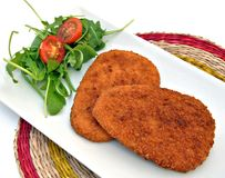 Two breaded steak Stock Images