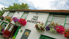 Two Brewers Public House Georgian Architecture Flowers Hanging Baskets Display Stock Image