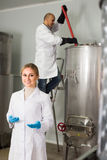 Two brewery workers on beer factory Stock Photography