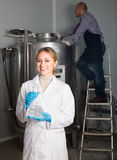 Two brewery workers on beer factory stock photos