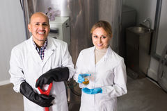 Two brewery workers on beer factory Royalty Free Stock Image